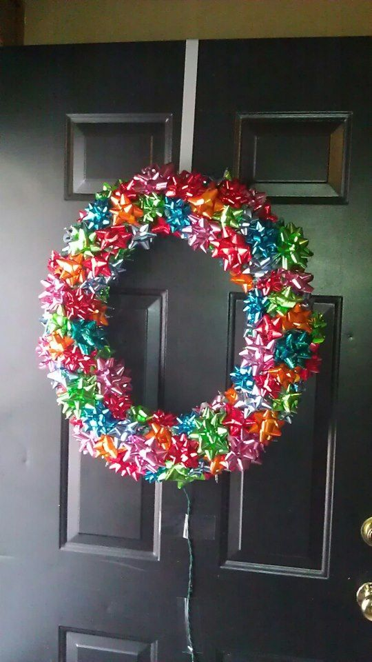 Adorable colorful bow wreath for front door decoration at Christmas.
