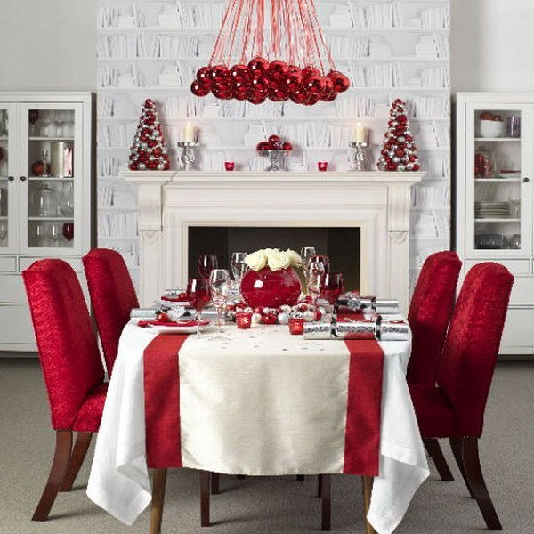 Adorable red and white dinning area decor with red ornament chandelier.