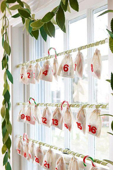 Amazing pouch advent calendar hanging on window.