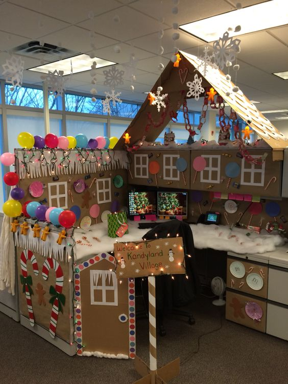 amazingly decorated office cubicle on christmas eve with cardboards balloons and diy crafts