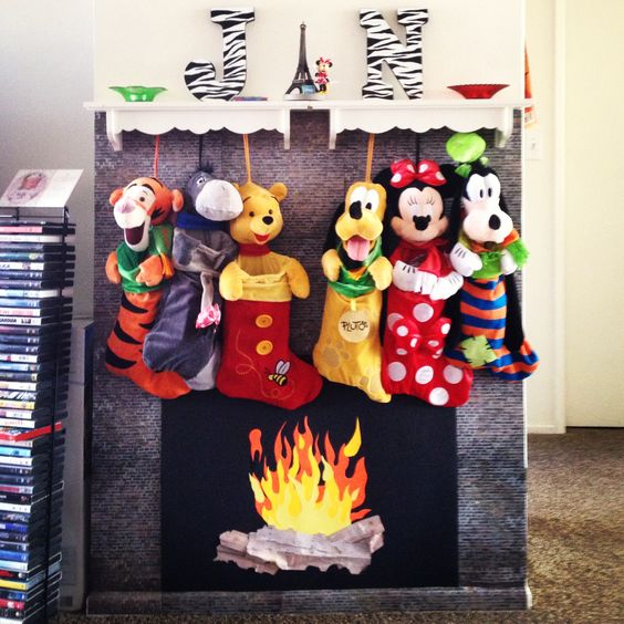 Artificial fireplace and mantel with disney stockings at Christmas.