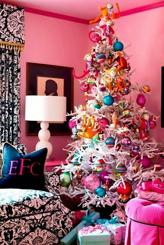 Awesome colorful ornaments and toys to decorate white Christmas tree.