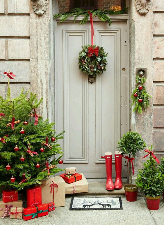 Awesome front porch decor with wreath, leaves and red shoes.