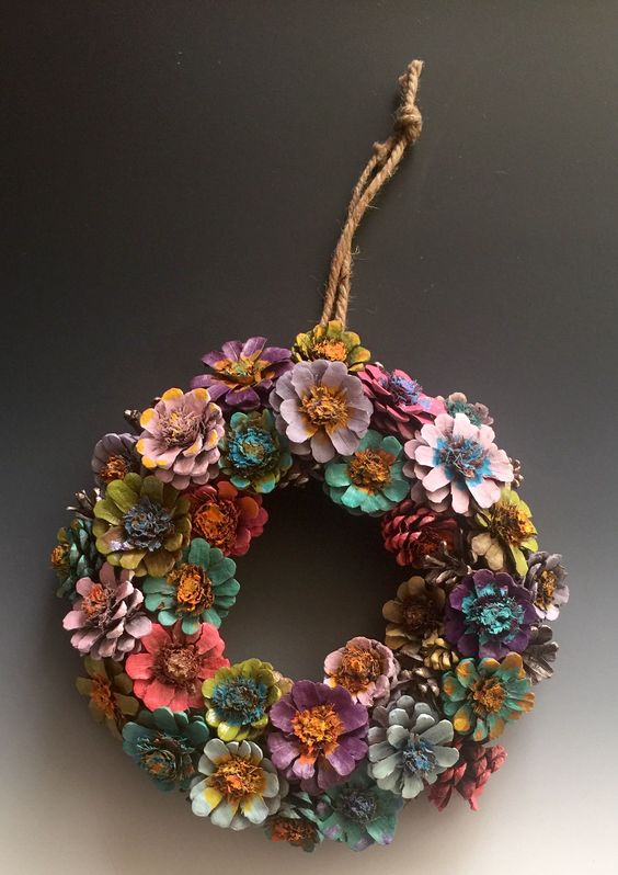 Awesome pinecone flower wreath.