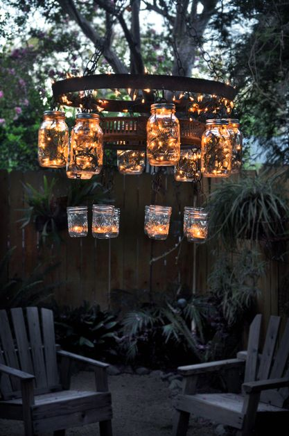 Awesome recycled mason jar chandelier for outdoor Christmas decor.