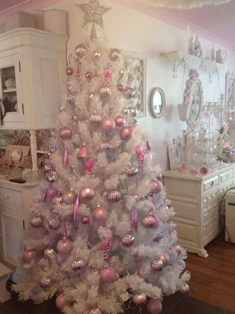 Beautiful white Christmas tree with pink and silver ornament, candy and star topper.