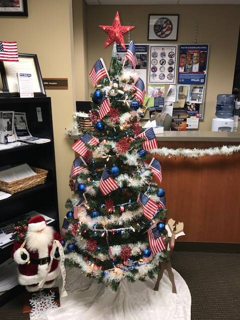 beautifully decorated christmas tree with blue balls and flags