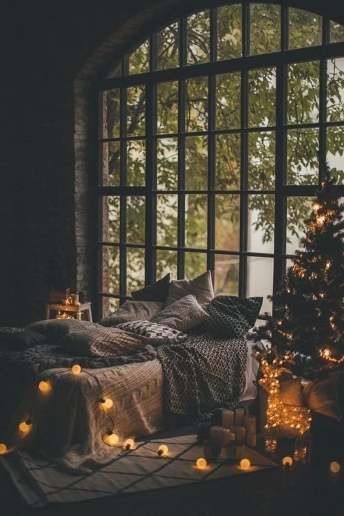 Beautifully decorated lights on Christmas tree, reindeer and bed