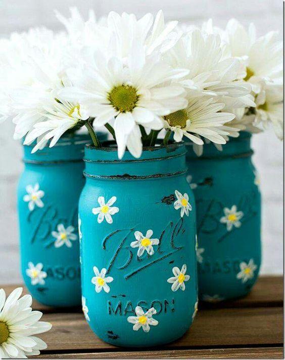 Beautifully decorated mason jar as flower vase.