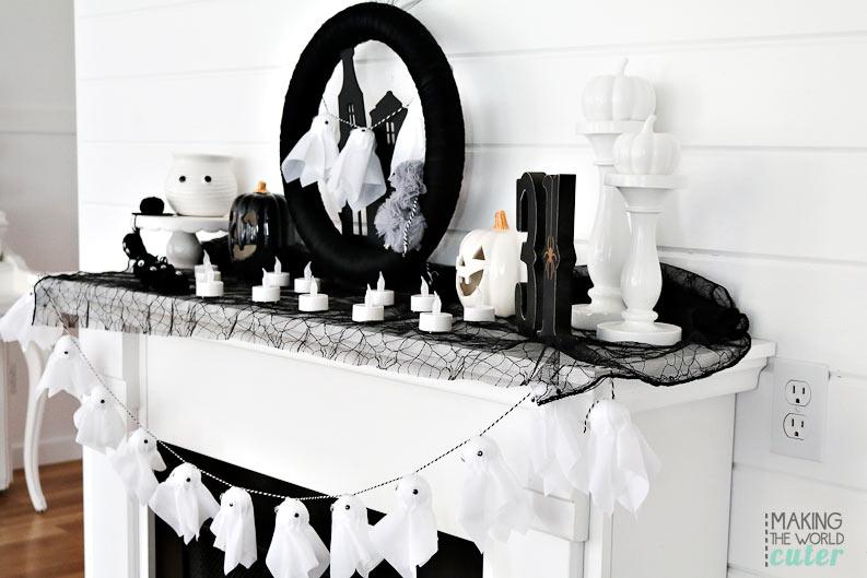 Black and white halloween mantel decor.