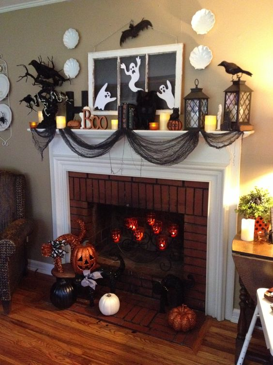 Black cheese cloth to look like webs, pumpkins, crows and ghost to decorate mantel.