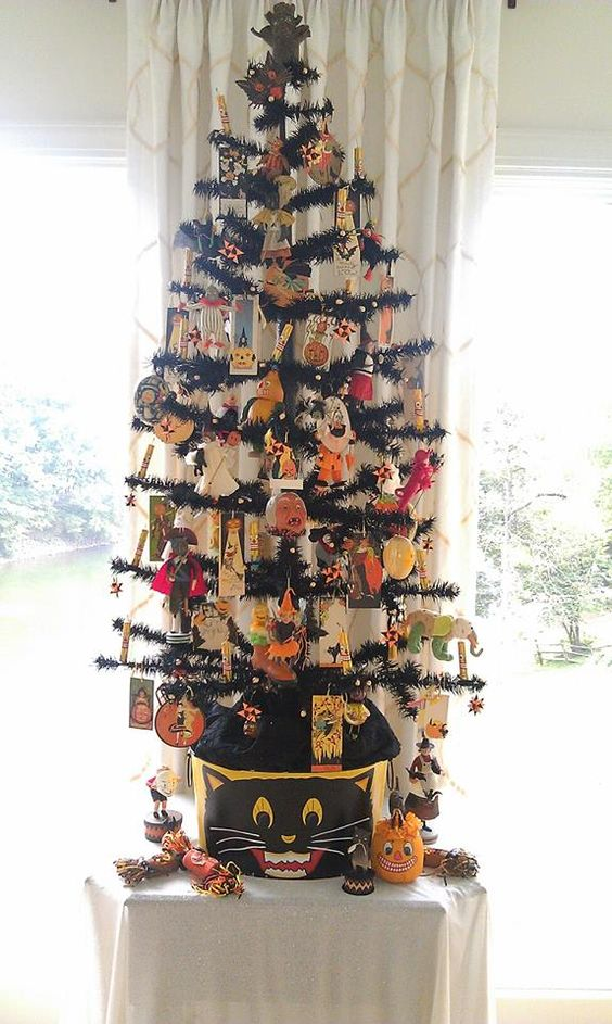 Black feather tree for Halloween decorated with creepy ornaments.