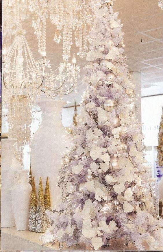 Blooms and balls In white for white X Mas tree decoration.