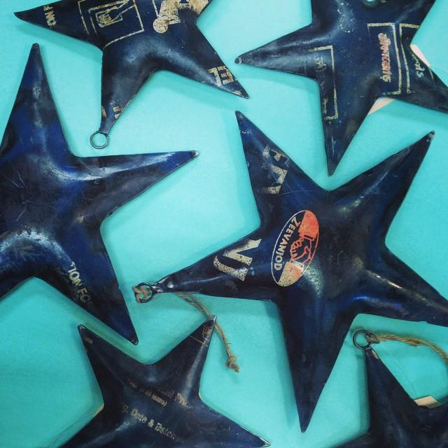 Blue metal star ornament for Christmas tree.