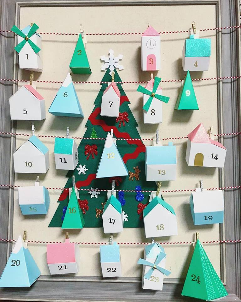 Cardboard home advent calendar with full of surprises.