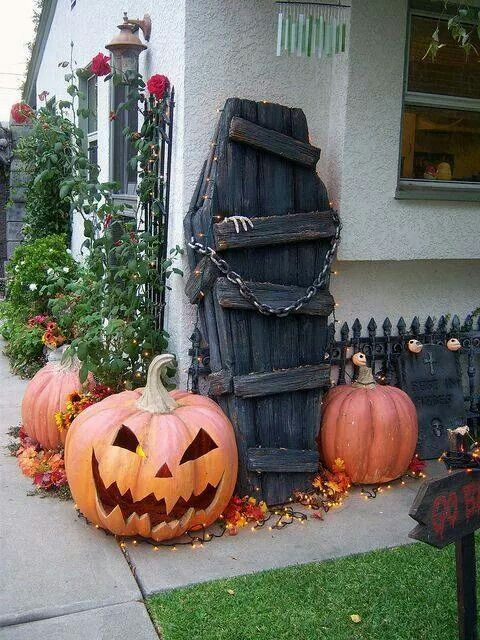 Carved pumpkins, lights and coffin to decorate outdoor for Halloween party.