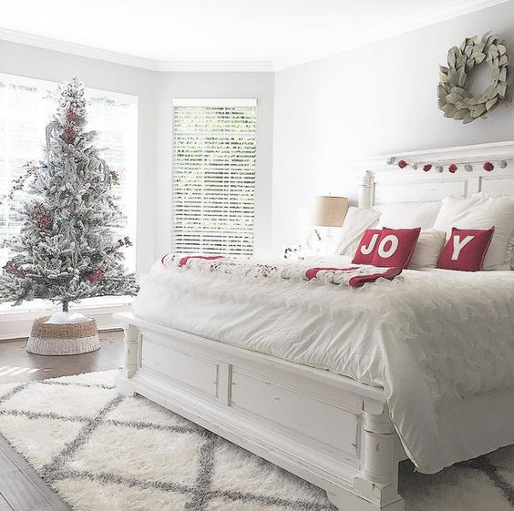 Charismatic bedroom decor with Christmas tree and JOY pillow covers.