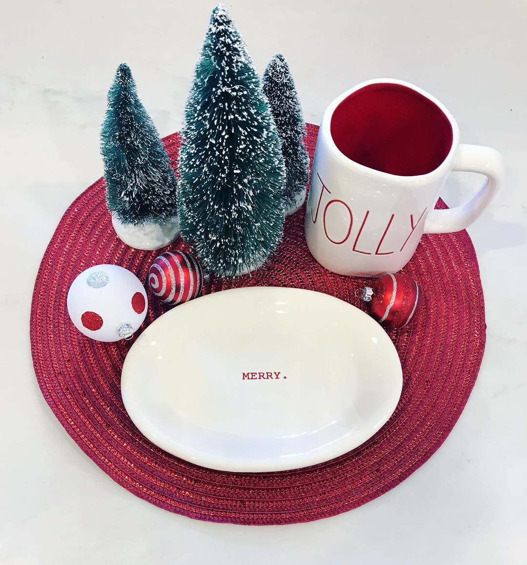 Charismatic red and white home decor with little brush Christmas tree.