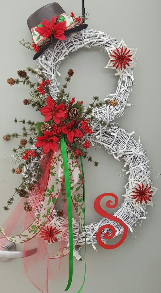 Chic Rustic Double Tier Christmas Wreath Decorated With Light And Fresh Flowers.