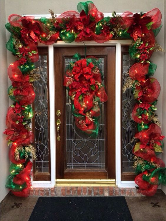 Chic red and green ribbon with lights on front door.