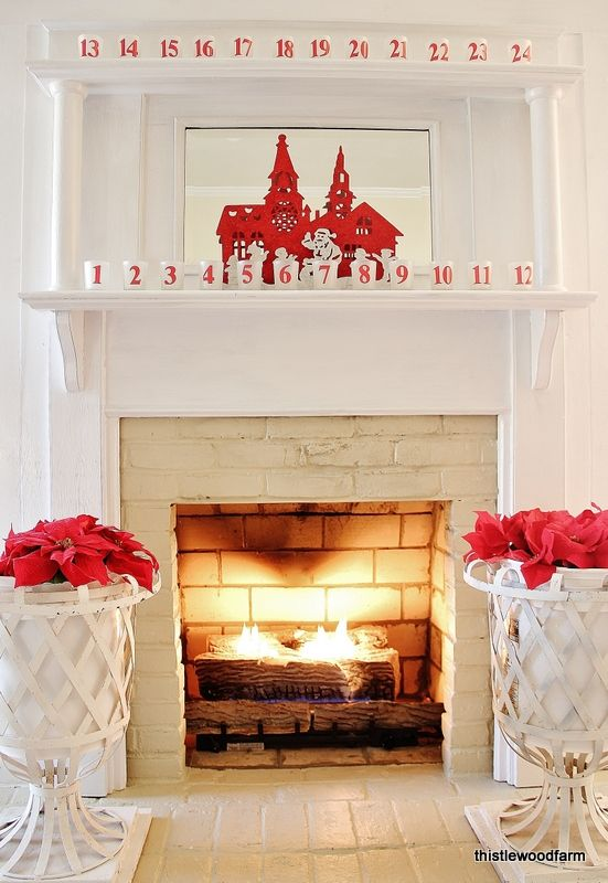 Chic red and white mantel and fireplace Christmas decoration idea.