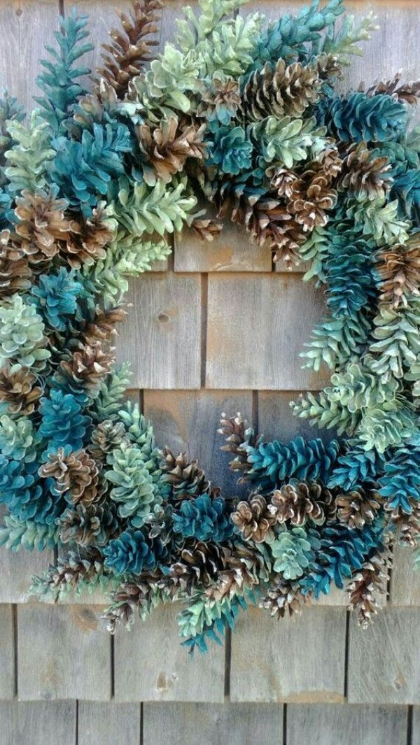 Colorful and beautiful pinecone wreath.