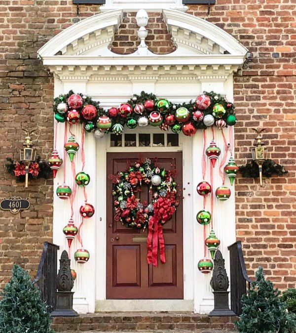 Colorful bubbles garland, hangings and wreath with red bow.