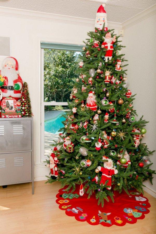 Cool vintage style santa doll hanging on tree.