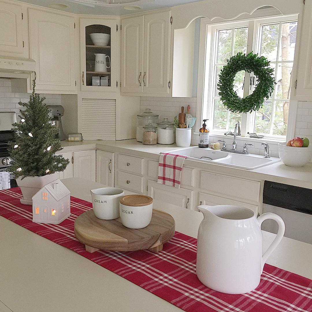 Cottage Christmas kitchen decor with red and white plaid cloth.