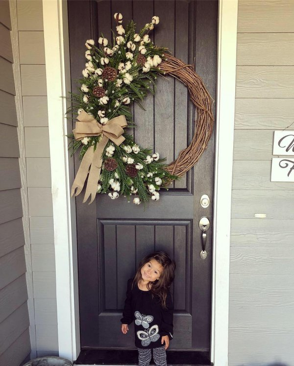 Country living style front door decoration for holidays.