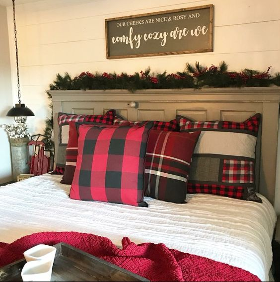Cozy bedroom decor with plaid cushion.