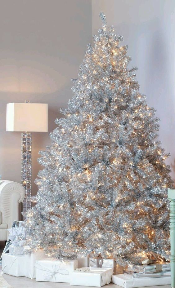 Cozy white Christmas tree decorated with solely lights.