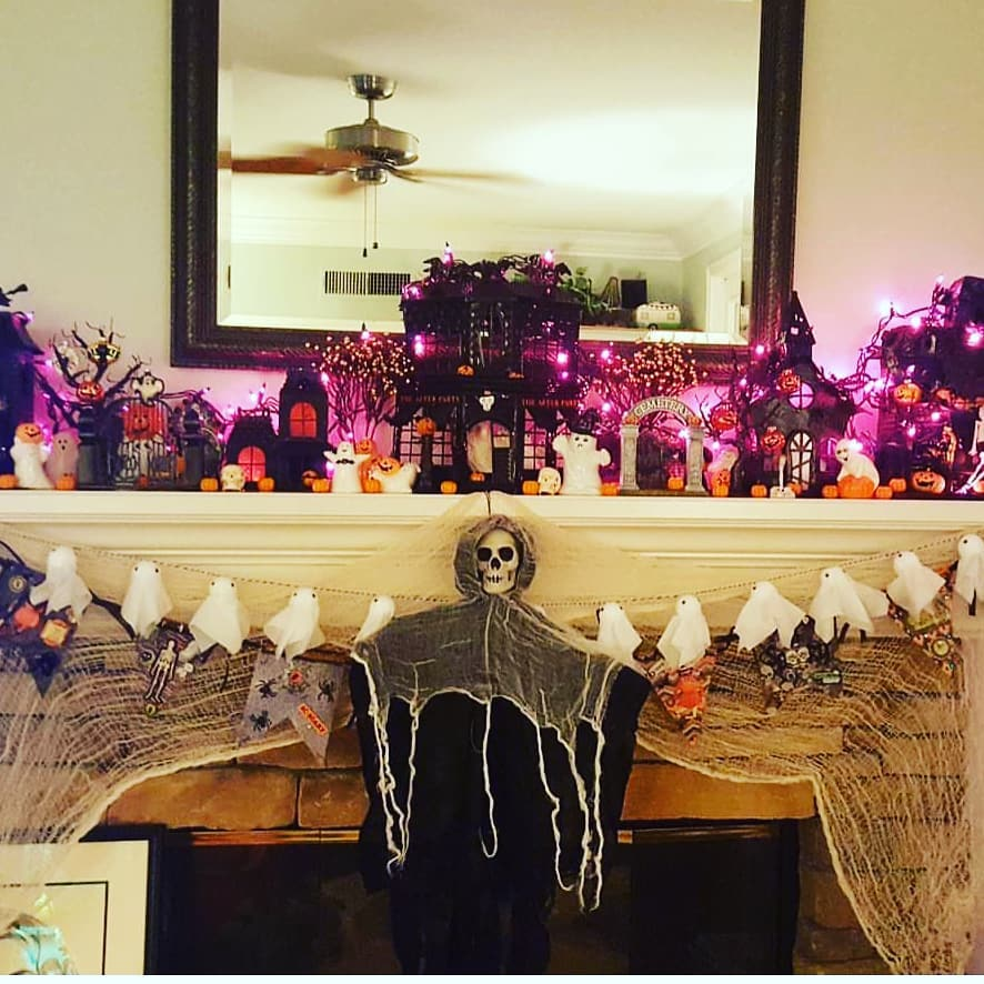 Cute ghost garland, skeleton and lights for Halloween Mantel decor.