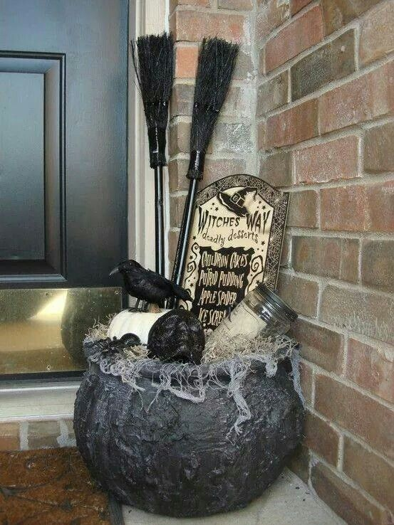 DIY witch broomstick and crow Halloween decor for party.