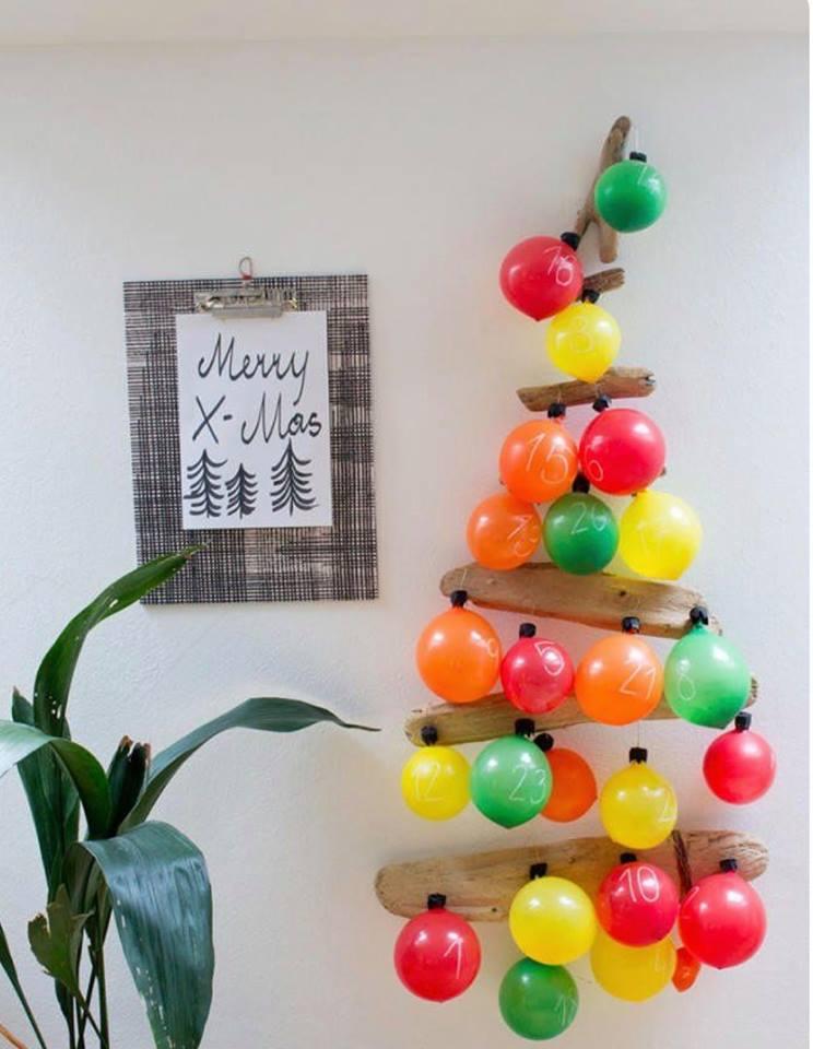 Dashing colorful balls advent calendar on wall.