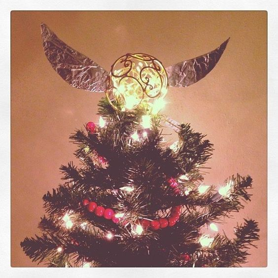 dashing golden snitch christmas tree topper - Harry Potter Christmas Decorating Ideas