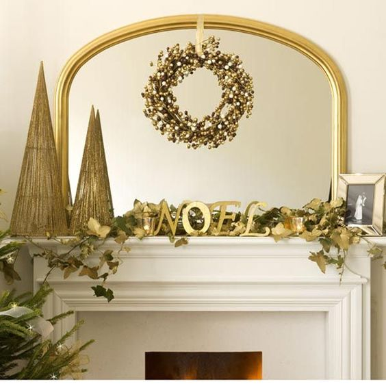 Dazzling golden berries wreath, cone and leaves at fire place for Christmas party decoration.