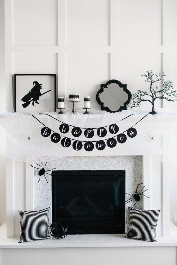 Elegant black and white halloween mantel decor.