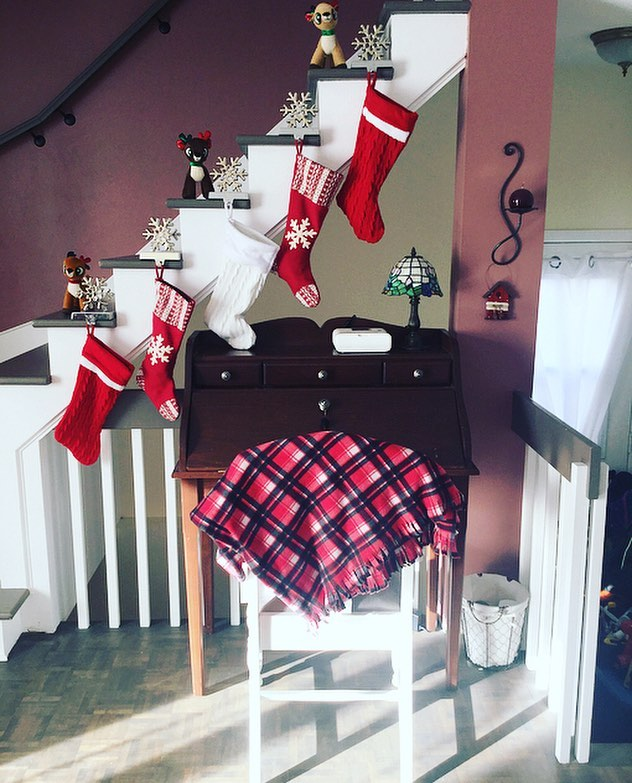 Elegant red and white stocking for stairs decoration.