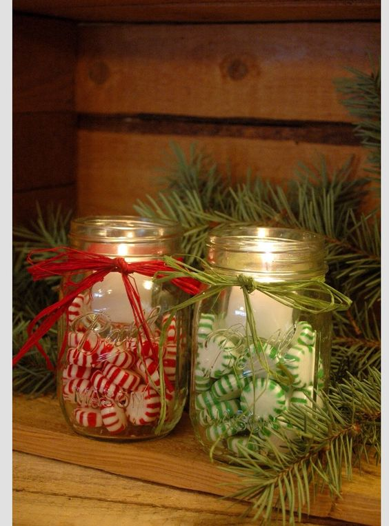 Empty Mason Jar is Filled with Red and Green peppermint and used as candle holder.