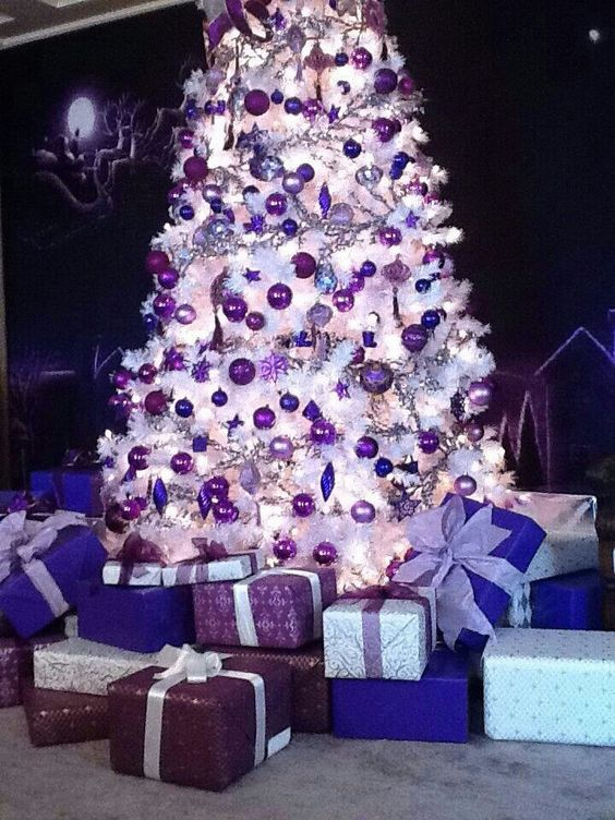 Enchanting white Christmas decoration with purple ornaments.