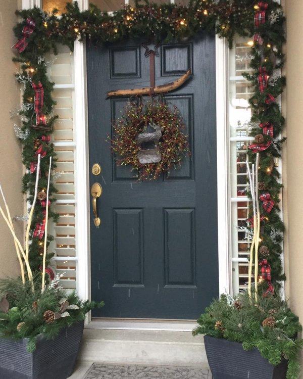 Exclusive rustic wreath on the door with garland.