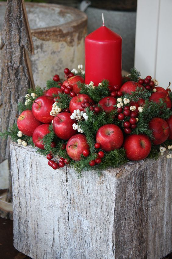 Eye Catchy Red Candles With Apples and Berries.