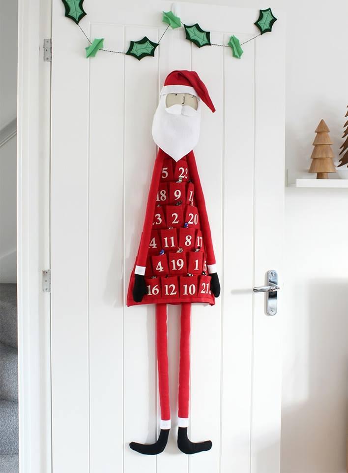 Fabric Santa advent calendar for kids room.