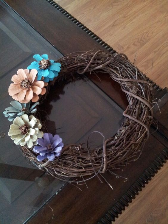 Fabulous painted pinecone flowers on a grapevine wreath.