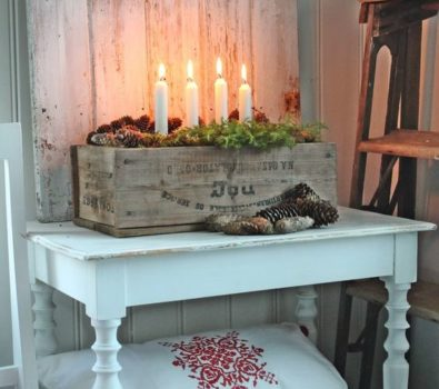 Fabulous wooden box candle holder with pinecones, wreath, pillows and blanket for winter.