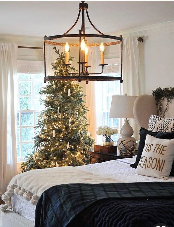 Farmhouse style Christmas bedroom decor with tree and Chandelier.