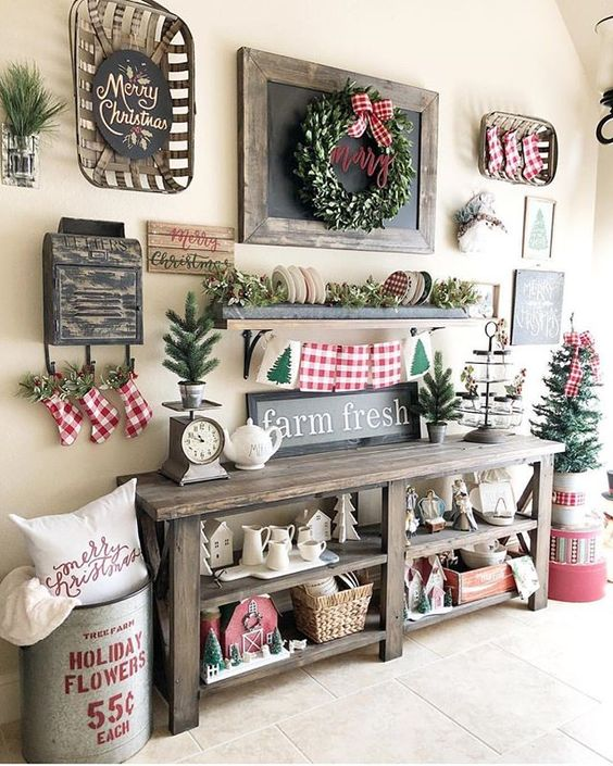 Farmhouse style decoration with fresh garland, mini trees and stockings.