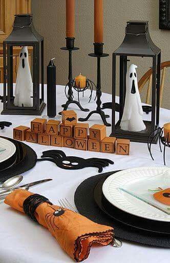 Ghost inside the lantern, blocks and spider napkins on table.