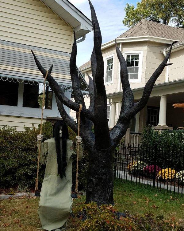 Ghost on swing Halloween outdoor party decor idea.